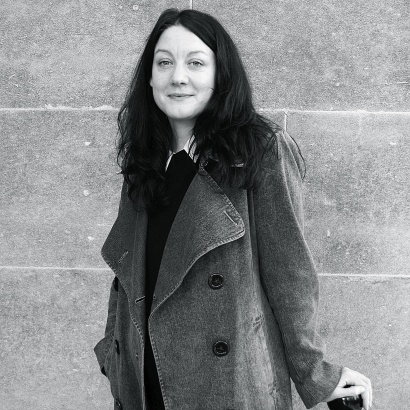 H is for Hawk author Helen MacDonald in black and white looking directly at camera