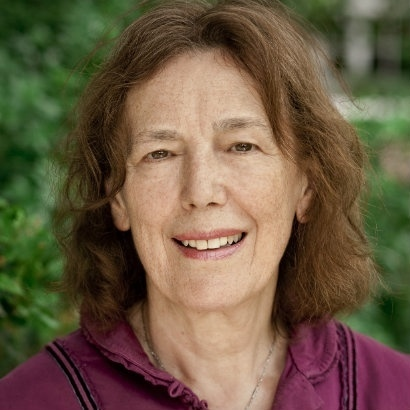 Picture of author Claire Tomalin in front of some trees.