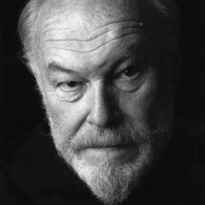 Close-up image of Timothy West's face, with an entirely black background
