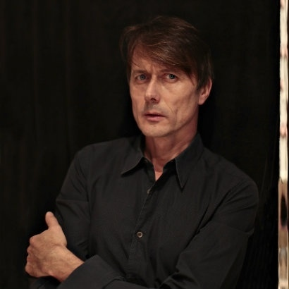 Image of Brett Anderson looking serious in a black shirt