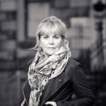 black and white photo of Kate Atkinson in a leather jacket and big scarf