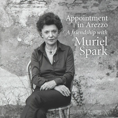 Black and white image of Muriel Spark sitting in a chair in front of a rustic wall, with the text from the book cover of Appointment in Arezzo, A friendship with Muriel Spark in white on the image