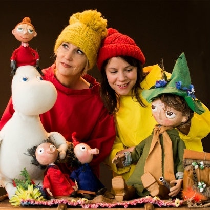 Get Lost and \found puppets of the momis with two puppeteers dressed in wintery clothes