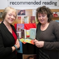 MLF board member stands with poet laureate Carol Ann Duffy in a library