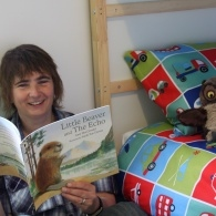 MLF Director Cathy Bolton reading a colurful picture book