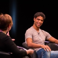 Writer and Dancer Carlos Acosta smiling onstage at The Lowry during MLF13